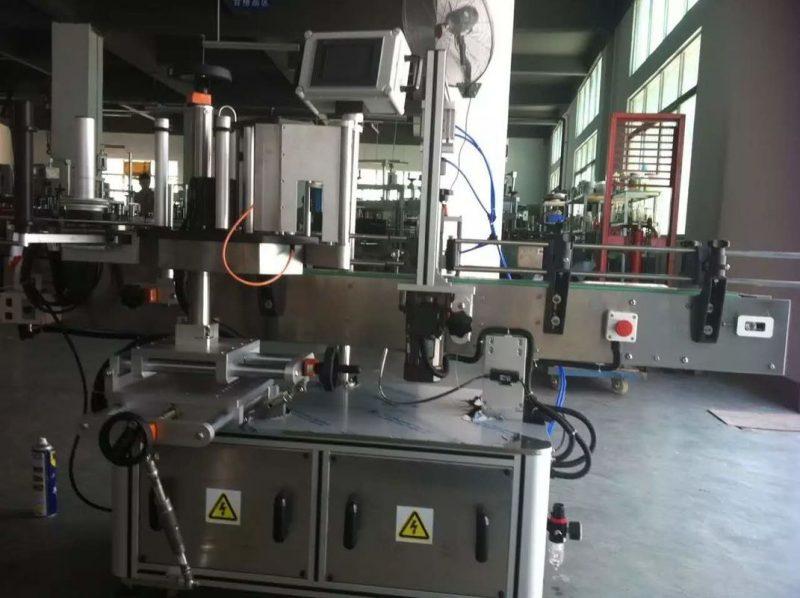 Хятад улсын Жимс / Хүнсний ногооны жүүс, ундааны үйлдвэрт зориулагдсан дугуй шилэн наалт шошголох машин
