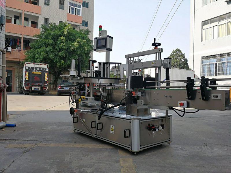 Хятад улс Өндөр хурдны автомат гурван талт дөрвөлжин лонхны шошго түрхэх машиныг нэг шошготой нийлүүлдэг